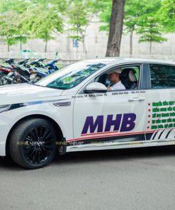 Dán tem sườn quảng cáo đơn vị MHB trên xe Kia Cerato